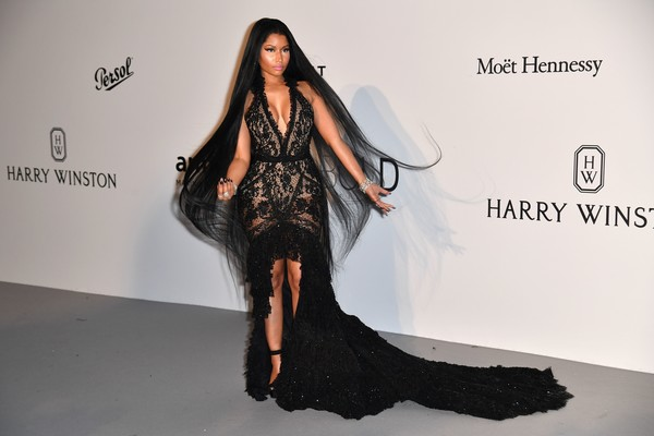 Nicki Minaj hit the amfAR Gala Cannes 2017 wearing a deep-V black fishtail gown by Roberto Cavalli Couture.