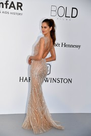 Izabel Goulart wowed in a crystal-adorned nude Zuhair Murad gown with an open back at the amfAR Gala Cannes 2017.