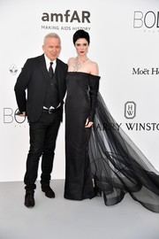 Coco Rocha was goth queen in a black Jean Paul Gaultier off-the-shoulder gown with a sweeping tulle train at the amfAR Gala Cannes 2017.