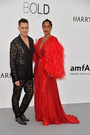 Tracee Ellis Ross stood out so glamorously in a voluminous red Jenny Packham wrap gown with feather sleeves at the amfAR Gala Cannes 2017.