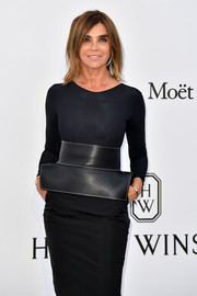 Carine Roitfeld styled her simple outfit with a statement belt by Loewe for the amfAR Gala Cannes 2017.