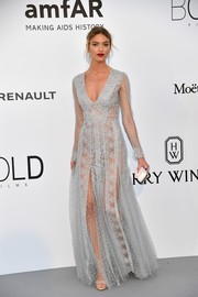 Martha Hunt looked sweet- while staying on trend in sheer- in a long-sleeve blue lace gown at the amfAR Gala Cannes 2017.