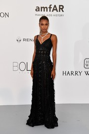Jasmine Tookes opted for a classic embroidered and ruffled gown by Zuhair Murad when she attended the amfAR Gala Cannes 2017.