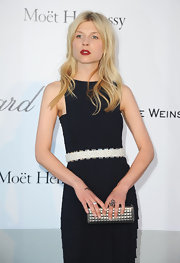 Clemence Poesy added shine to her stunning amfAR Gala look with a quilted pewter leather Resort 2012 clutch.
