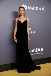 Alessandra Ambrosio was sultry and sophisticated in a black Tommy Hilfiger gown with bedazzled shoulder straps and an open back at the 2018 amfAR Hong Kong Gala.