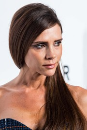 Victoria Beckham wore her long tresses swept to the side when she attended the amfAR Hong Kong Gala.