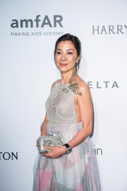 Michelle Yeoh arrived for the amfAR Hong Kong Gala carrying an elegant printed clutch.