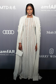Naomi Campbell ravished in a sheer white lace gown by Ralph & Russo Couture at the amfAR Hong Kong Gala.