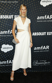 Karolina Kurkova completed her silver accessories with an embellished chain-strap bag.