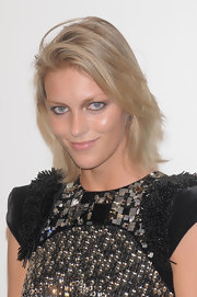 Anja Rubik styled her layered locks in a deep side part for the amfAR Milano event.