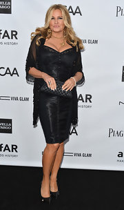 Jennifer Coolidge is keeping it saucy in this black lingerie-inspired corset dress.