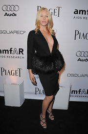 Angela Featherstone donned strappy black heels with her low-cut and furry black dress. The subtle, yet sexy shoes kept the look from being over the top.