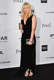 Beth Behr looked luxe at the amfAR Inspiration Gala in this deep-V velvet number.