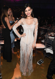 Victoria Justice flashed plenty of skin in a sheer white gown by Pamella Roland at the amfAR Inspiration Gala Los Angeles.