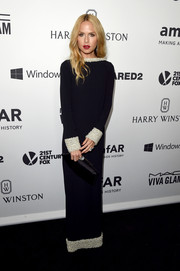 Rachel Zoe went ultra elegant at the amfAR Inspiration Gala in a black column dress from her own line, featuring a heavily embellished neckline, cuffs, and hem.
