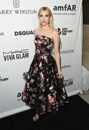 Emma Roberts amped up the sweetness in a fit-and-flare floral strapless dress by Alexander McQueen at the amfAR Inspiration Gala.
