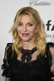Courtney Love topped off her look with messy waves and  parted bangs when she attended the amfAR Inspiration Gala Los Angeles.
