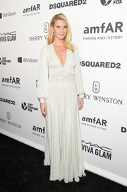 Gwyneth Paltrow was the picture of timeless elegance in a micro-beaded white gown by Ralph & Russo Couture at the amfAR Inspiration Gala.