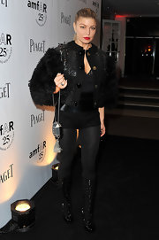 Fergie added sizzle to her step at the amfAR Inspiration Gala in black patent Fall 2011 Cag boots.