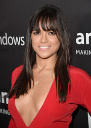 Michelle Rodriguez kept it casual with this long straight 'do with eye-grazing bangs at the amfAR Inspiration LA Gala.