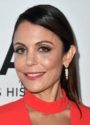 Bethenny Frankel wore her hair down with the sides tucked behind her ears when she attended the amfAR Gala in Los Angeles.