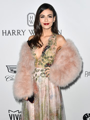 Victoria Justice arrived for the amfAR Gala in Los Angeles wearing the Rebecca Minkoff Pacha feather jacket, in blush.