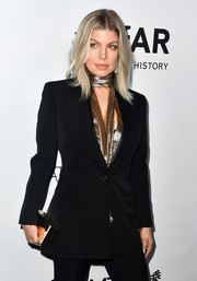 Fergie styled her black suit with a mirrored box clutch when she attended the amfAR Gala in Los Angeles.