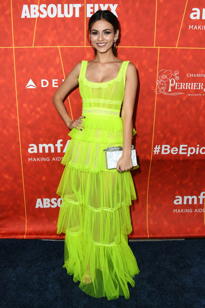 Victoria Justice lit up the black carpet with this tiered neon-green gown by Aadnevik at the amfAR Gala Los Angeles 2018.