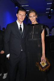 Anja Rubik complemented her classic LBD with an eclectic feathered and beaded clutch when she attended the amfAR Milano event.