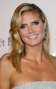 Heidi Klum chose a pale pink lipstick to complement her smoky eyes at the amfAR Milano 2011 event. To try her look, we recommend a product like Covergirl Wetslicks Lipgloss in Tutu.