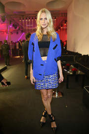 Poppy Delevingne styled a black mesh crop-top with an electric-blue jacket for the amfAR Milano after-party.