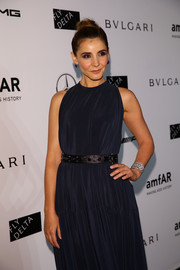 Clotilde Courau styled her dress with an edgy studded belt for the 2014 amfAR Milano Gala.