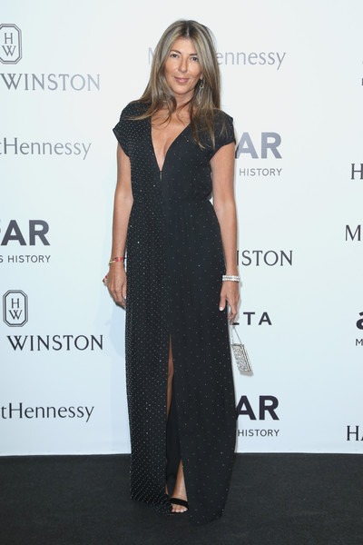 Nina Garcia donned a subtly beaded black gown for the amfAR Milano 2015.