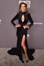 Alessandra Ambrosio looked provocative in a high-slit black keyhole-cutout gown by Lena Berisha at the 2019 amfAR New York Gala.