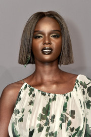 Duckie Thot wore her hair in a blunt bob with an off-center part at the 2019 amfAR New York Gala.