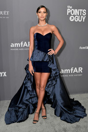 Lais Ribeiro got glam in a strapless navy dress with a high-low hem and ruffle detailing for the 2019 amfAR New York Gala.