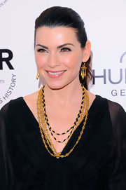 Julianna paired her V-neck dress with a layered gold neckalce.