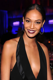Joan Smalls attended the 2012 amfAR Gala wearing a rich matte burgundy lipstick.