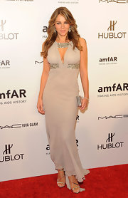 Elizabeth Hurley showed off her impossible figure in this cream evening dress for the the amfAR New York Gala to kick off Fashion Week.