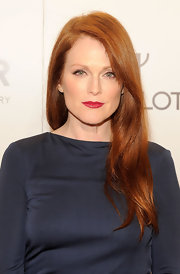 Julianne Moore wore her long fiery locks in sleek layers at the 2012 amfAR Gala.