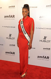 Leila Lopes looked fiery in this red draped gown at the amfAR Fashion Week gala.