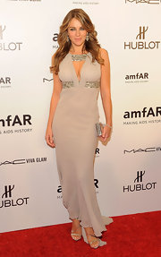 Elizabeth Hurley topped off her elegant evening gown with embellished metallic sandals.
