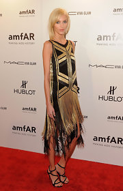 Anja Rubik topped off her black and gold frock with black strappy sandals.
