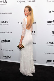 Toni Garrn looked lovely in a white lace gown with a deep plunging back at the amfAR gala.
