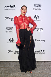 Olivia Culpo continued the flirty vibe with a black lace and ruffle maxi skirt, also by Zuhair Murad.