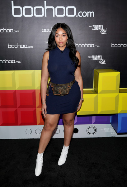 Jordyn Woods paired her frock with white ankle boots.