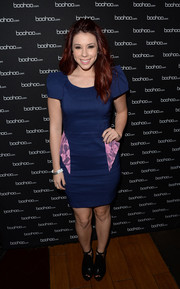 Jillian Rose Reed chose chunky black cutout boots by BCBGeneration to pair with her dress.