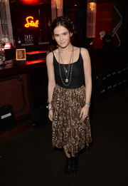Zoey Deutch looked breezy in a black camisole at the boohoo.com event.