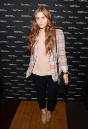 Holland Roden was dressed down in a patterned blazer and baggy pants at the boohoo.com event.