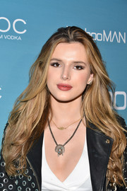 Bella Thorne attended the boohoo.com LA pop-up store opening wearing her signature long waves.